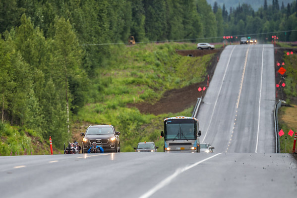 July 26, 2015: Muffy Davis leads a group of racers up a hill on the Parks Highway during stage seven of the 2015 Alaska Challenge handcycle race.