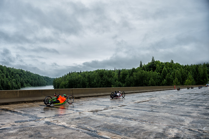 July 26, 2015: Ryan Kelling leads a group of racers across a bridge near the start of stage seven of the 2015 Alaska Challenge handcycle race.