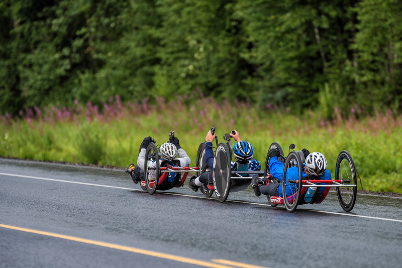 July 26, 2015: Muffy Davis leads a group of racers along the Parks Highway during stage seven of the 2015 Alaska Challenge handcycle race.
