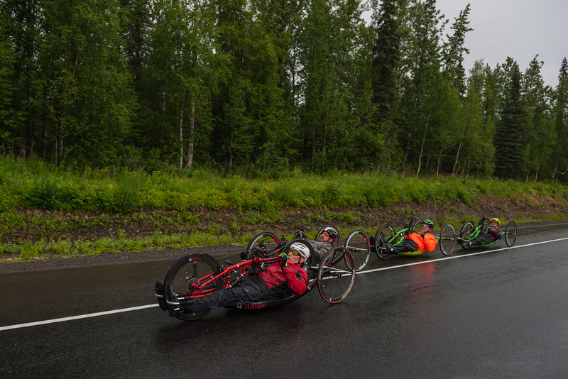 July 26, 2015: Kenny Herriot, David Bergin, Keith Winchell and Ryan Kelling race along the Parks Highway during stage seven of the 2015 Alaska Challenge handcycle race.