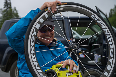 July 26, 2015: Muffy Davis checks her tire pressure before the start of stage seven of the 2015 Alaska Challenge handcycle race.