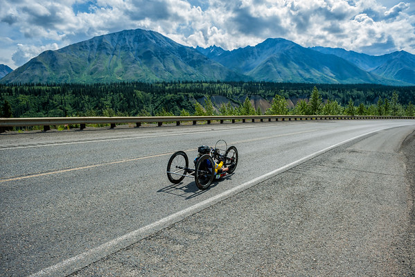 July 25, 2015: Ashli Molinero races along the Parks Highway during stage six of the 2015 Alaska Challenge handcycle race.