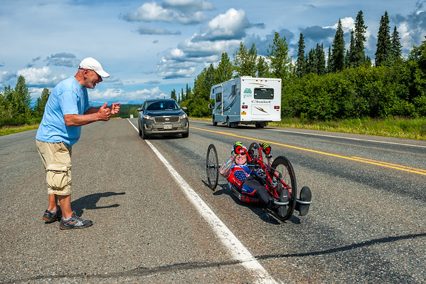 July 25, 2015: Kenny Herriot is cheered on during stage six of the 2015 Alaska Challenge handcycle race.