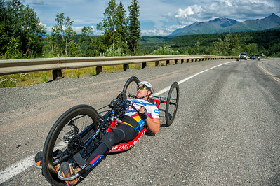 July 25, 2015: Muffy Davis races along the Parks Highway during stage six of the 2015 Alaska Challenge handcycle race.