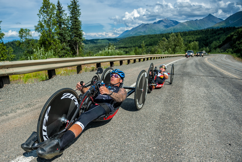 July 25, 2015: Anthony Pedeferri and Muffy Davis race along the Parks Highway during stage six of the 2015 Alaska Challenge handcycle race.