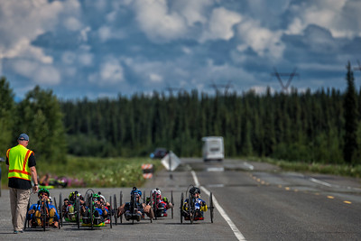July 25, 2015: The racers line up for the start of stage six of the 2015 Alaska Challenge handcycle race.