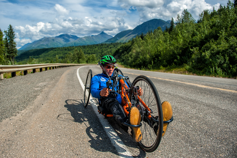 July 25, 2015: Andrew Kurka races along the Parks Highway during stage six of the 2015 Alaska Challenge handcycle race.