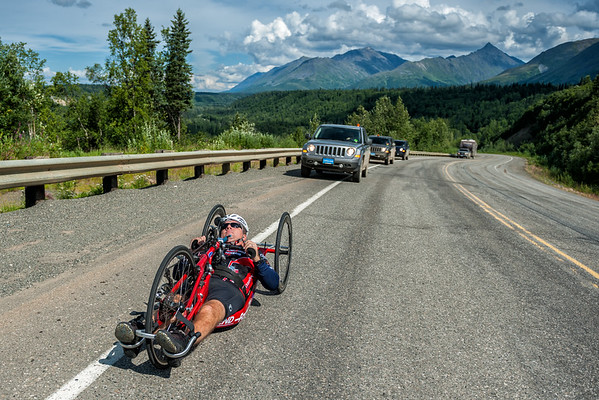 July 25, 2015: Wesley Bergin races along the Parks Highway during stage six of the 2015 Alaska Challenge handcycle race.