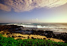 High angle view of ocean waves breaking on the beach at dusk, Poipu Beach, Kauai, Hawaii, USA