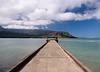 View down the pier at Hanalei in Kauai towards the Na Pali coast