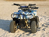 Small All Terrain Vehicle on a beach 2