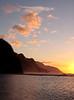 Vertical format of the headlands of the Kauai coast illuminated at sunset