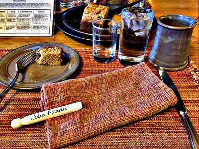 The seating is changed daily. It's fun to look for your personal keepsake napkin pin to find your assigned table.