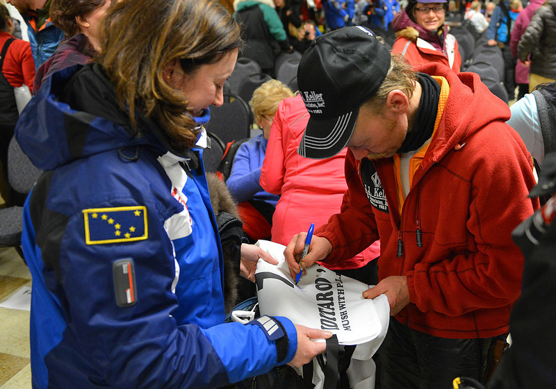 Mitch Seavey won his second Iditarod after claiming the 2013 race. Seavey autographs an Iditarod bib for a fan.