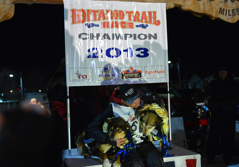 Mitch Seavey won his second Iditarod after claiming the 2013 race. Seavey sits under the burled arch in downtown Nome with his leaders Tanner (left) and Taurus (right).