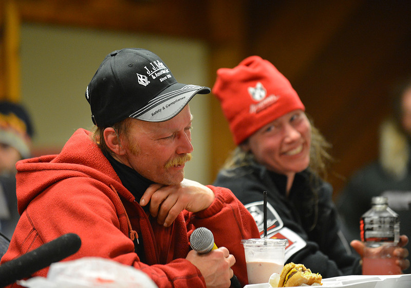2013 Iditarod champion Mitch Seavey shares a light-hearted moment with runner-up Aliy Zirkle in a press conference held shortly after the two mushers had crossed the finish line in Nome, AK.
