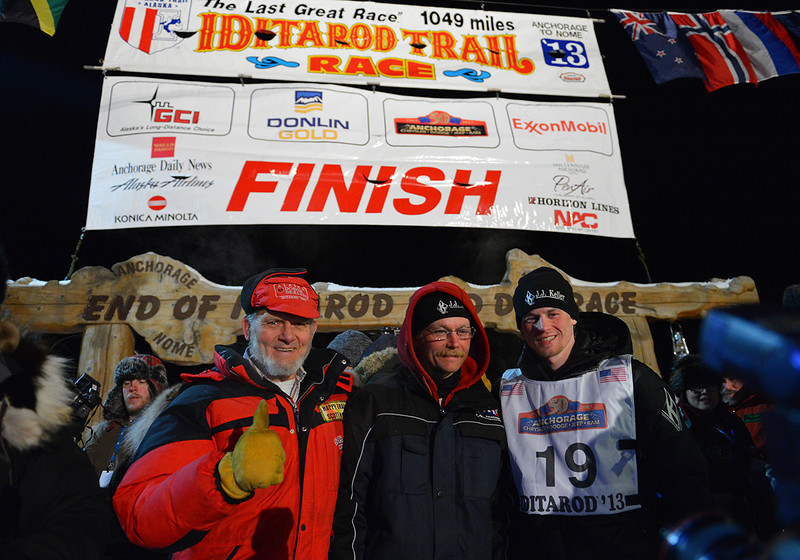 A generation of Seavey mushers, Dan (left), Mitch (middle) and Dallas (right), pose for a photo under the burled arch in downtown Nome, the finish line for the famed Iditarod dogsled race. Mitch Seavey claimed his second Iditarod title while Dallas Seavey finished in fourth place.