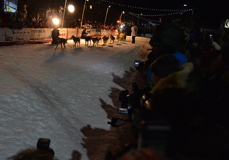 Mitch Seavey brings his team down the chute toward the finish line of the 2013 Iditarod.