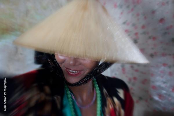 Market woman with lipstick Hoi An, Vietnam