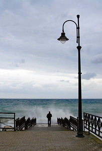 Man Stands on Pier by Heavy Sea, Amalfi Coast (Italy)