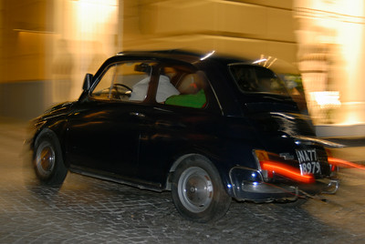 Classic Fiat 500 Driving Through Night-time Sorrento, Italy