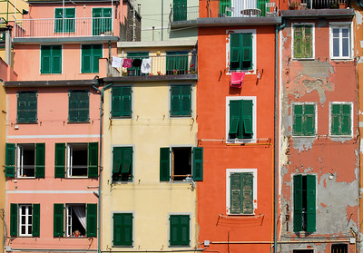 Shuttered Windows on Colourful Facades of Houses in Riomaggiore, Cinque Terre (Italy)