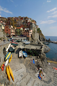 Picturesque Cliff-top Houses and the Marina (Harbour) of the Village of Manarola in Cinque Terre (Italy)