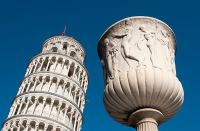 Sculpture and Leaning Tower of Pisa, Italy