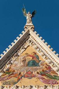 Gable of Facade of Cathedral (Duomo) of Siena with Mosaic representing Coronation of Virgin by Luigi Mussini, Tuscany, Italy