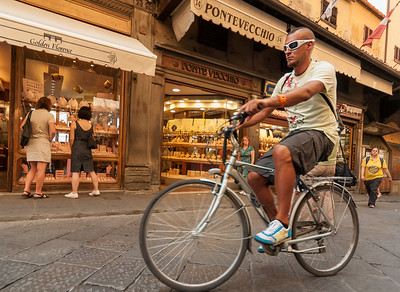 Young Man Riding Bicycle, Ponte Vecchio, Florence (Firenze), Tuscany (Toscana), Italy
