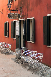 Chairs in front of Trattoria, Italy