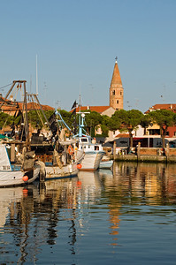 Fishing Boats and Yachts on Water Canal with Duomo Bell Tower (Campanile) in Background, Caorle, Veneto, Italy