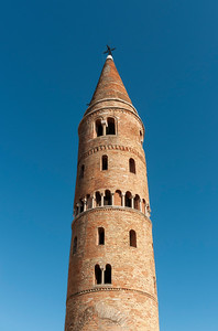 Cylindrical Bell Tower (Campanile) of Romanesque Cathedral of St. Stephen (Duomo), Caorle, Veneto, Italy