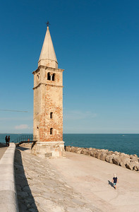 Bell tower - Lighthouse of Church of Blessed Virgin of Angel (Santuario della Madonna dell'Angelo) on Adriatic Sea, Caorle, Veneto, Italy