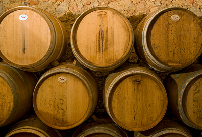 Oak Barrels at Wine Cellar, Chianti, Italy