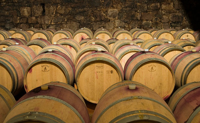 Oak Barrels at Wine Cellar, Italy