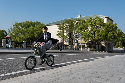 Cyclists outside Rest House of Hiroshima Peace Park, Japan