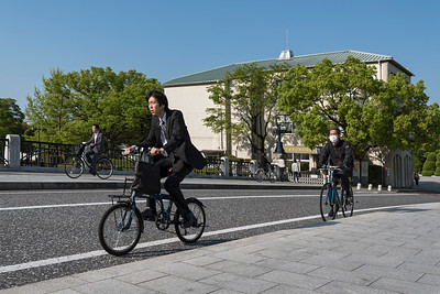 Cyclists outside Rest House of Hiroshima Peace Park, Japan