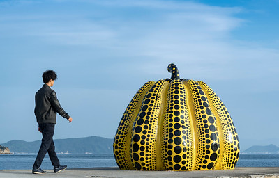 Japanese Tourist and Yellow Pumpkin of Kusama Yayoi, Naoshima, Japan