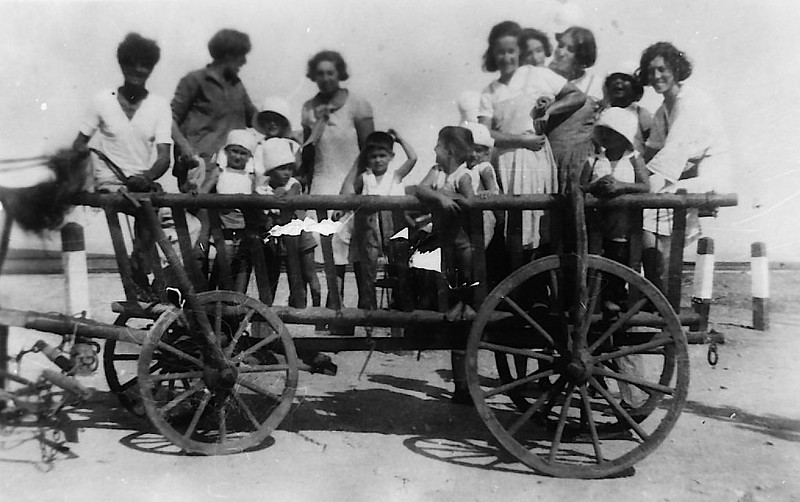 First Kids on a Wooden Wheel Carriage