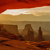 Washer woman at sunrise seen through  Mesa Arch, Canyonlands, Utah