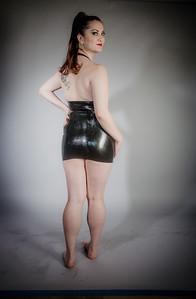 lola in a black plunge line latex dress