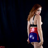 Porcelain in multi-colored latex, booty skirt, and see through bra halter top. Shot at Studio5Graphics Seattle
