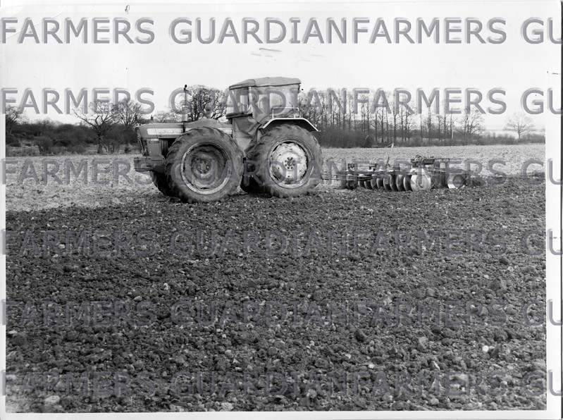 """April 1967- Seedbed preparations, a County Super Six towing 9'6"""" discs and weighted harrows in tandem."""