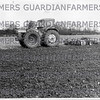 "April 1967- Seedbed preparations, a County Super Six towing 9'6"" discs and weighted harrows in tandem."
