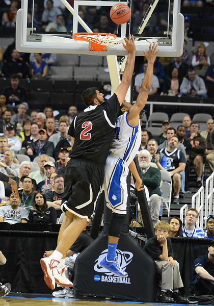 March 21, 2013: New Mexico State Aggies center Sim Bhullar (2) blocks a shot during a game between the New Mexico State Aggies and the Saint Louis Billikens in the second round of the NCAA Division I Men's Basketball Championship at HP Pavilion in San Jose, California.