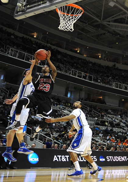 March 21, 2013: New Mexico State Aggies guard Daniel Mullings (23) hangs in the air for a shot during a game between the New Mexico State Aggies and the Saint Louis Billikens in the second round of the NCAA Division I Men's Basketball Championship at HP Pavilion in San Jose, California.