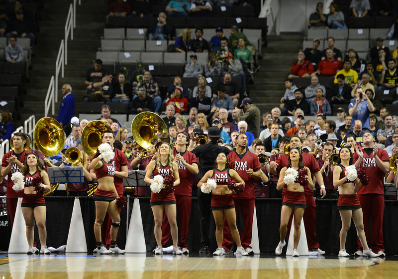 March 21, 2013: New Mexico State Aggies cheerleaders watch the jumbotron in a timeout during a game between the New Mexico State Aggies and the Saint Louis Billikens in the second round of the NCAA Division I Men's Basketball Championship at HP Pavilion in San Jose, California.