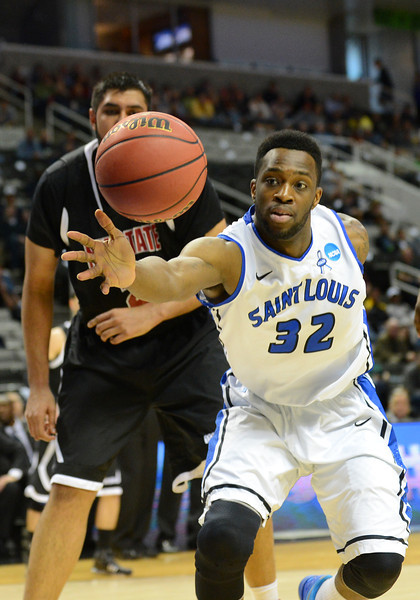 March 21, 2013: Saint Louis Billikens forward Cory Remekun (32) reaches for a loose ball during a game between the New Mexico State Aggies and the Saint Louis Billikens in the second round of the NCAA Division I Men's Basketball Championship at HP Pavilion in San Jose, California.