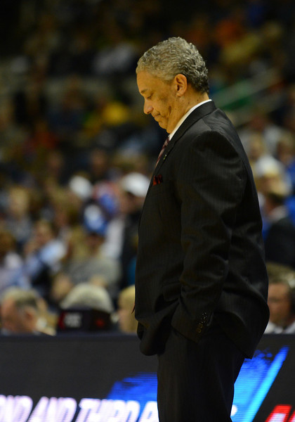 March 21, 2013: New Mexico State Aggies head coach Marvin Menzies looks down in disappointment during a game between the New Mexico State Aggies and the Saint Louis Billikens in the second round of the NCAA Division I Men's Basketball Championship at HP Pavilion in San Jose, California.